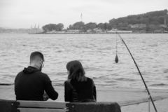 Fishing rod in the middle of people royalty free stock photo