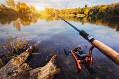 Fishing rod near beautiful pond Stock Photo