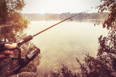 Fishing rod near pond in the morning Royalty Free Stock Images