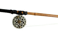 Fishing-rod with old spinning-wheel Royalty Free Stock Photo