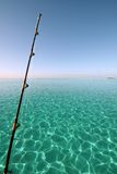 Fishing rod over blue lagoon Royalty Free Stock Image