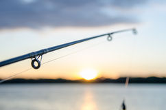 Fishing rod with over a lake Royalty Free Stock Photo