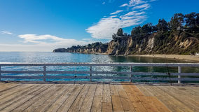 Fishing rod on a peer in Malibu, Los Angeles. Fishing rods on a peer in Malibu, Los Angeles with a nice view over a beautiful cove Stock Photos