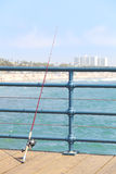 Fishing rod on pier. Royalty Free Stock Photography