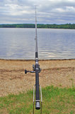 Fishing rod. And a pond in the background Royalty Free Stock Image