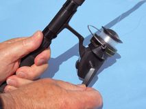 Fishing rod and reel. Worlds most popular passtime  , fishing Stock Image