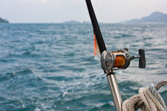 Fishing rod and reel on a boat Royalty Free Stock Photography
