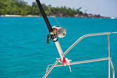 Fishing rod and reel on a boat Stock Image