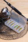 Fishing rod and reel with box for baits. Stock Image