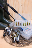Fishing rod and reel with box for baits. Royalty Free Stock Images
