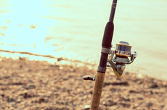 Fishing rod, and reel Royalty Free Stock Photo
