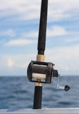 Fishing Rod and Reel. Deep sea fishing rod on seascape background royalty free stock image