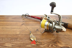 Fishing rod and reel Royalty Free Stock Photos