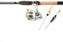 Fishing rod with reel and fishing buoys isolated on white background with free space Royalty Free Stock Photography