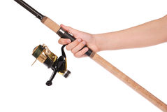 Fishing rod, reel in hand Stock Photo