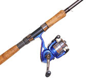 Fishing rod and reel isolated over white Royalty Free Stock Image