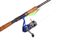 Fishing rod and reel, isolated Royalty Free Stock Image