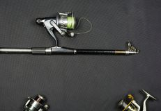 Fishing rod and reels. Fishing rod and reels with place for description Royalty Free Stock Images