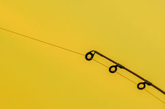 Fishing rod rings close up with isolated background. Fishing rod rings close up with yellow blurred background Stock Image