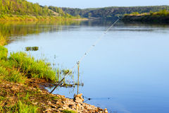 Fishing rod on the river. Day Stock Images