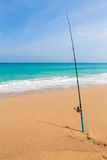 Fishing rod in sand of tropical beach Royalty Free Stock Images
