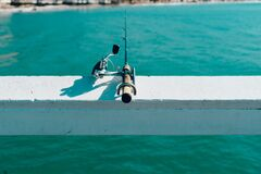 Fishing rod by sea Stock Images