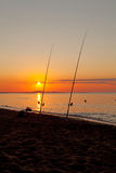 Fishing rod at sea by sunset Royalty Free Stock Image