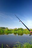 Fishing Rod (Spinning Rod) over Lake Royalty Free Stock Photos
