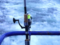 Fishing-rod with spinning-wheel Stock Photos