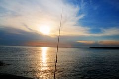 Fishing rod at sunset Royalty Free Stock Photography
