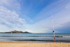 Fishing rod at te Playa de Muro beach in Mallorca, Spain