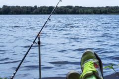 The fishing rod stands a fishing line and the fishing gear is th royalty free stock photography