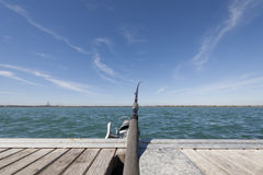 Fishing rod waiting Stock Images