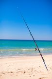 Fishing rod in white sand on tropical beach Royalty Free Stock Photos