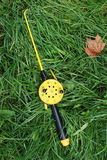 Fishing rod with yellow reel Stock Photo