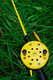 Fishing rod with yellow reel Royalty Free Stock Photo