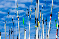 Fishing rods against the sky. Images taken while on a Fishing trip in Bar Harbor Maine USA royalty free stock photo