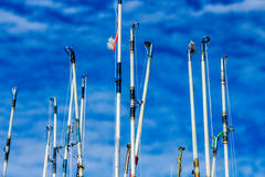 Fishing rods against the sky. Images taken while on a Fishing trip in Bar Harbor Maine USA royalty free stock images