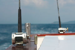 Fishing rods and bollard Stock Photos