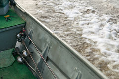 Fishing rods and equipment in moving river boat. An abstract crop of fishing rods and equipment inside a motorboat as it moves along a river Stock Photography