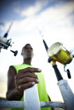 Fishing rods and a fisherman Royalty Free Stock Photos