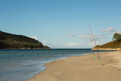 Fishing Rods on a Galician Beach Royalty Free Stock Photo