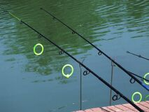fishing-rods-on-lake Royalty Free Stock Photography