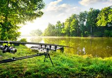 Fishing rods near river Stock Image