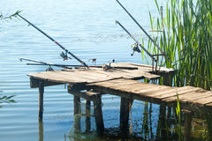 Fishing rods on old pontoon Royalty Free Stock Photography