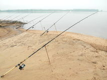 Fishing. Rods placed beside the lake Stock Images