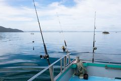 Fishing rods on a charter boat at sea in Far North District, Nor royalty free stock photos