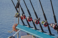 Fishing rods and reels fishing line. Six fishing rods and reels fishing line royalty free stock image
