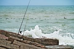 Fishing rods and reels on jetty royalty free stock images