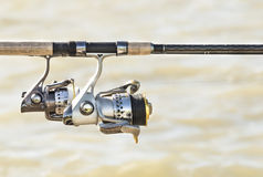 Fishing rods and reels on the lake.  Stock Image